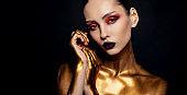 close-up beauty portrait fashion model, clean skin, black background, hairstyle high bun, art creative fashion photography,  gold makeup