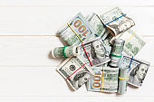 Many Stack of 100 dollar bills. Isolated on colored background top wiev with copy space