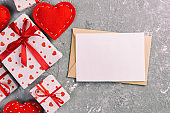 Envelope Mail with Red Heart and gift box over grey cement Background. Valentine Day Card, Love or Wedding Greeting Concept