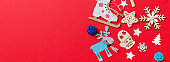 Top view Banner of holiday toys and decorations on red Christmas background. New Year time concept with copy space