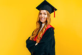 Happy graduate, on a yellow background. Concept of the graduation ceremony