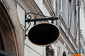 Blank Antique Black Store Signboard Mock up. Empty Shop Street sign on Ancient Wall in European Town