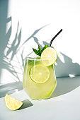 Detox peach beverage in glass garnish mint. Close up.