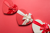 Valentine's Day romantic gifts with hearts on red.