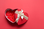 Valentine's Day hearts gifts on red. Flat lay. Romance greeting card with copy space.