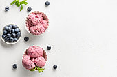 Berry and fruit ice cream, sorbet in bowls on white background. View from above. Copy space