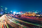 Night traffic blurs past Seoul Station