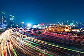 Night traffic blurs past Seoul Station