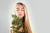 Closeup portrait of beauty woman spa green leaf, asia face perfect healthy glow skin, asian beautiful girl. Beauty clinic skincare organic natural spring earth day environment concept banner
