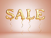SALE text as golden floating balloons. Isolated on a pink background, clipping path included.