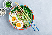 Asian Udon or Ramen noodles miso soup in bowl with Bok Choy and boiled egg