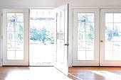 Open Door In Brightly Lit Room