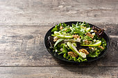 Fresh Waldorf salad with lettuce, green apples, walnuts and cele