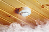 smoke detector in wooden house, fire alarm in action
