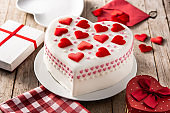 Heart cake for St. Valentine's Day, Mother's Day, or Birthday, decorated with roses and pink sugar hearts