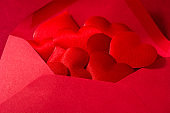 Red paper envelope with hearts