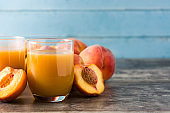 Natural peach juice in glass