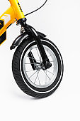 part of kids bicycle wheel with spokes, white background
