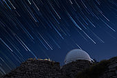 Astronomical observatory with star trails
