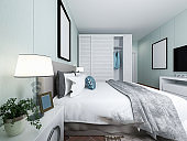 3D rendering, elegant and spacious bedroom design of modern apartment, overcoat cabinet beside the big bed, with dressing table and green plants