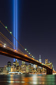 Tribute in Light with the Brooklyn Bridge and the skycrapers of Lower Manhattan. Financial District, New York City