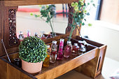 vintage dressing table with decor and bottle of perfume.