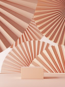 Abstract background for packaging presentation. Perfume on podium on nude color paper fan medallion background. 3d render.