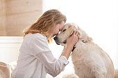 woman hugging her beloved big white dog. Animal communication concept