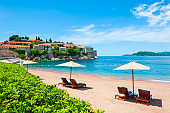 Sveti Stefan island with beautiful beach near Budva, Montenegro.