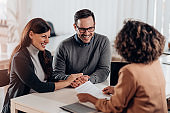 Couple talking to their insurance agent on a meeting