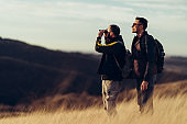 Two friends hiking in the hills