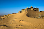 Abandoned houses in Kolmanskop ghost town, Namibia