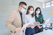 Business employees wearing mask during work in office to keep hygiene follow company polic