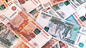 Background of banknotes of five and one thousand Russian rubles