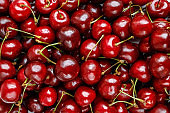 Ripe red sweet cherries top view, background