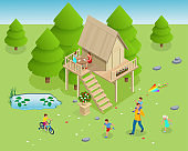 Isometric wooden house in the forest on the background of fir trees. Summer family vacation. Tree house in the evening garden