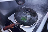 cooking process fried noodles with vegetables in the wok, traditional asian food