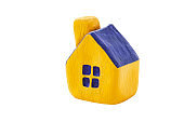 Miniature yellow toy house with a blue roof isolated on white background. Selective focus