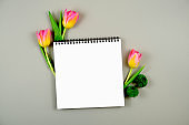 Notebook with flowers on a gray background