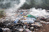 Garbage pollution from small towns  Incinerated and disposed of incorrectly A source of pollution And spread the disease.Smoke of burning garbage into the air- pollution from waste garbage .