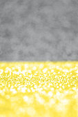 Sparkle Illuminating yellow on Ultimate Gray background. Colors of the year 2021. Glitter defocused bokeh wallpaper