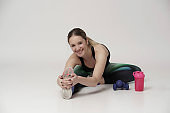 Cheerful Woman Exercising With Dumbbells Over Pink Background stock photo