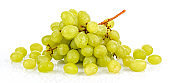 Wet green grapes with water drops on glossy surface on white background