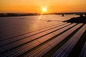 Sunrise over a modern solar farm
