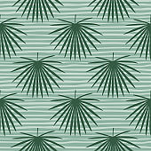 Seamless pastel soft botanic pattern with talipot leaf ornament. Green color elements on blue pastel striped background.