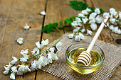 Acacia honey on a wooden background