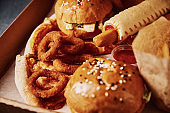 Unhealthy and junk food. Different types of fast food on the table, closeup
