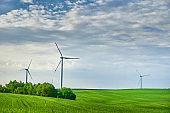 Wind turbine in the field. Wind power energy concept