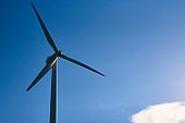 Wind turbine against blue sky. Wind power energy concept