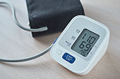 Digital blood pressure monitor on the table, closeup. Helathcare and medical concept